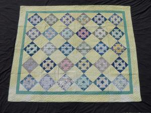 This quilt, made from sack scraps, is for sale by American Antiques,