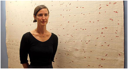 Jen Bervin in front of a Dickinson Fascicle; sewn cotton batting backed with muslin (via)